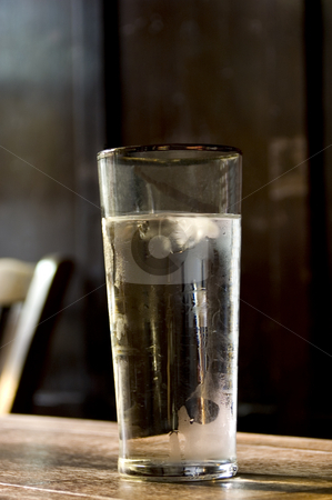 Water Glass stock photo, Glass of chilled water in a pub scene by Lee Torrens