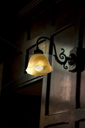 Old Lamp Shade stock photo, An old fashioned, wall-mounted, lamp shade by Lee Torrens