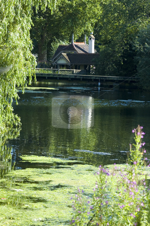 Little Cottage stock photo, View of a cute cottage across the lake at St James park (London) by Lee Torrens