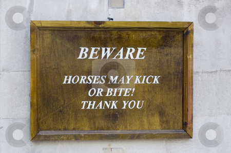 Beware Sign stock photo, Close up of a wooden sign by Lee Torrens