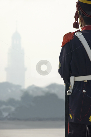 Soldier looking through the mist stock photo, An Argentinean ceremonial soldier looking through a smokey mist to a distant tower. by Lee Torrens