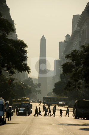 Inner City Buenos Aires stock photo, In the centre of the Argentina capital city of Buenos Aires, with the obelisk in the background and silhouetted people crossing the street. by Lee Torrens