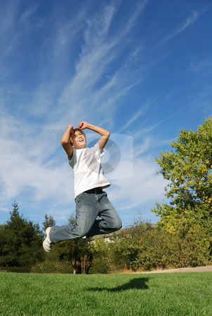Happiness stock photo, Boy expressing happiness by jumping in the park by Denis Radovanovic