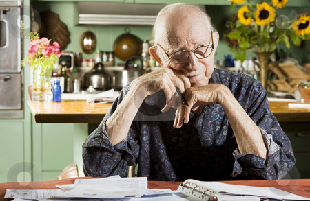 Man with Bills stock photo, Elder Man at Home with Bills by Scott Griessel