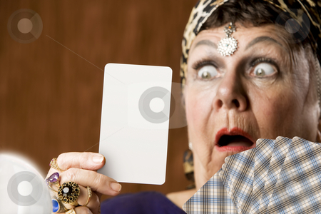 Fortune Teller with Blank Tarot Card stock photo, Gypsy fortune teller hiolding a blank tarot card by Scott Griessel