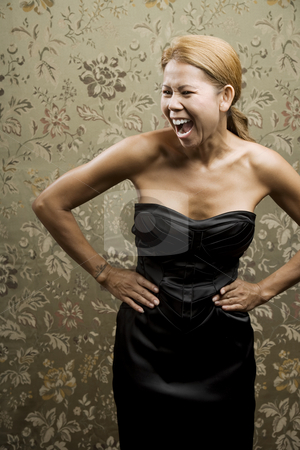 Pretty Ethnic Woman Laughing stock photo, Pretty Ethnic Woman Laughing in front of a Flowered background by Scott Griessel