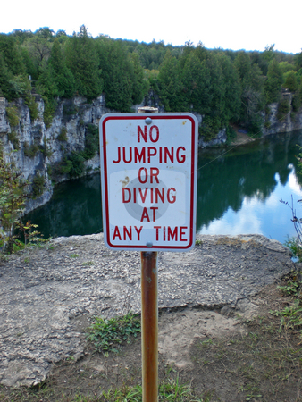 No diving from quarry cliff stock photo,  by J.G. Byers