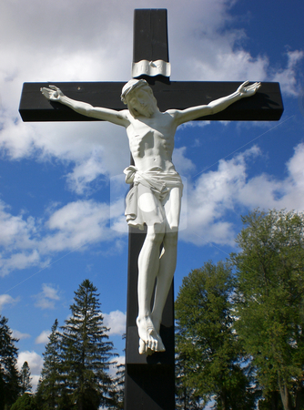 Pale christ on cross stock photo,  by J.G. Byers