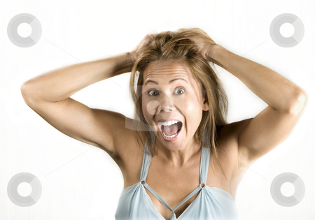 Ethnic woman pulling her hair stock photo, Pretty ethnic woman pulling on her hair by Scott Griessel