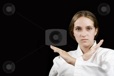 Young girl in a karate pose on black stock photo, Pretty young girl in a karate pose on black background by Scott Griessel