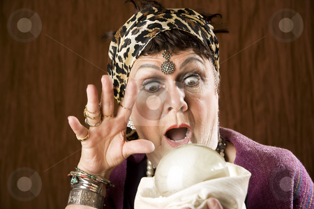 Gyspy with a crystal ball stock photo, Female gypsy fortune teller with a crystal ball by Scott Griessel