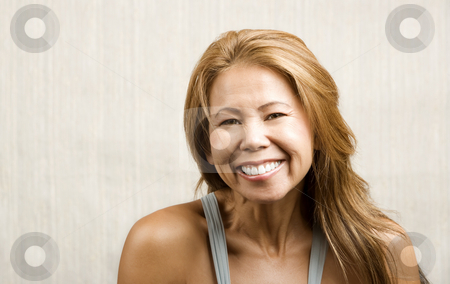 Ethnic woman on white print background stock photo, Pretty ethnic woman with an easy smile by Scott Griessel