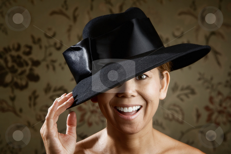 Ethnic woman in a black hat stock photo, Friendly ethnic woman in a big black hat by Scott Griessel