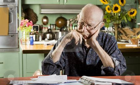 Man with Bills stock photo, Elder Man at Home with Bills by Scott Griessel