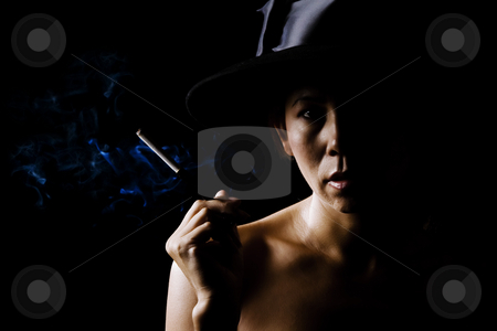 Woman in shadow wearing a black hat stock photo, Mysterious woman in shadows wearing by Scott Griessel