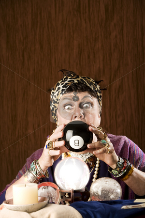 Gyspy predicting the future stock photo, Gypsy looking at an eight ball to predict the future by Scott Griessel