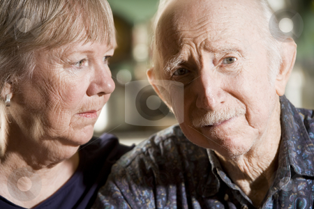Portrait of Worried Senior Couple stock photo, Close Up Portrait of Worried Senior Couple by Scott Griessel