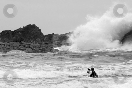 In the Face of the Tempest stock photo, A lone kayaker facing the explosive force of high tide on a stormy day at Ecola Starte PArk along the Oregon Coast by Mike Dawson