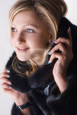 Warm in Fur stock photo, Portrait of a smiling beautiful girl in a fur coat by Vadim Maier