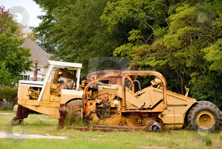 Earth Mover stock photo, An abandoned Earth Mover that has seen better days. by Robert Byron