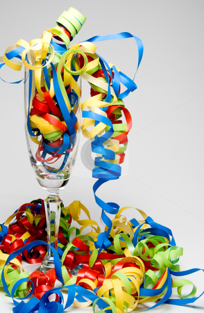 Wine Flute and Streamers stock photo, Party time with wine flute and streamers. by Robert Byron