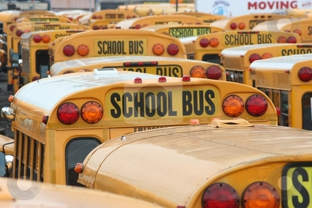 School Buses stock photo, A parking lot of School Buses by Ryan Bouie