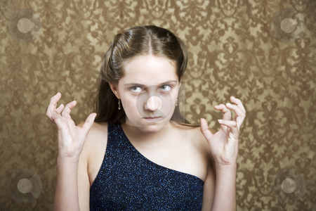 Frustrated Young Girl stock photo, Frustrated young girl in a blue party dress by Scott Griessel