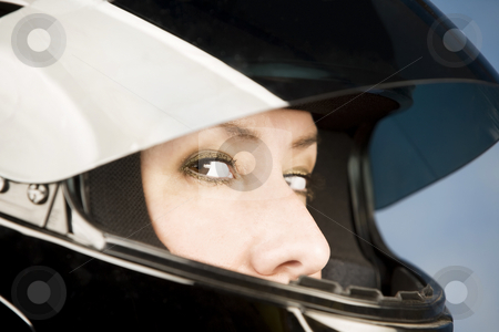 Hispanic woman with a motrcycle helmet stock photo, Hispanic woman wearing a black motrcycle helmet by Scott Griessel