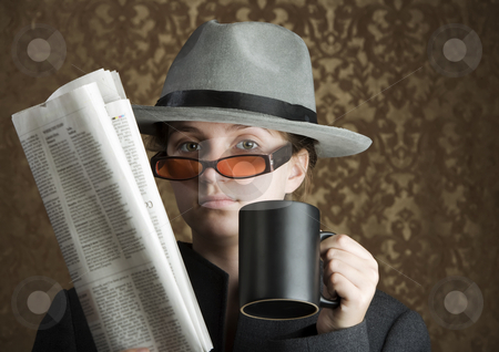 Young girl dressed in spy gear stock photo, Young girl wearing a fedora with newspaper and coffee by Scott Griessel