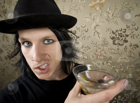Young Man with a Martini stock photo, Young Man with a Dark Hat and Martini by Scott Griessel