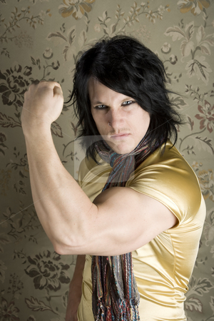 Young Man Flexing his Bicep stock photo, Young Man in a Yellow Shirt Flexing his Bicep by Scott Griessel