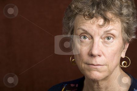 Portrait of a senior woman stock photo, Portrait of a smiling senior woman in an embroidered shirt by Scott Griessel