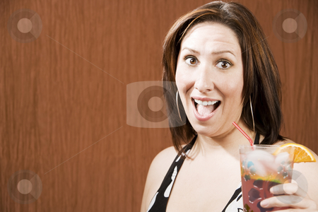 Hispanic woman with a drink stock photo, Hispanic woman having fun and holding a drink by Scott Griessel