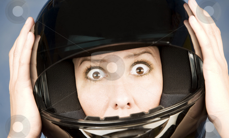 Woman with a motrcycle helmet and surprised expression stock photo, Woman with a black motrcycle helmet and surprised expression by Scott Griessel