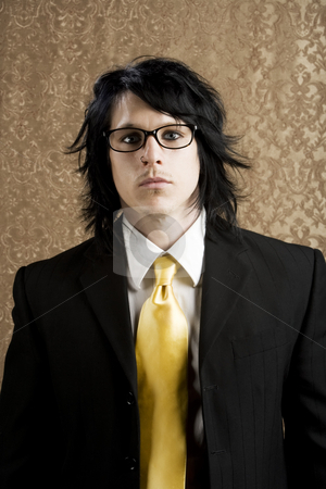 Hipster Businessman stock photo, Well-dressed businessman with a yellow tie and thick glasses by Scott Griessel