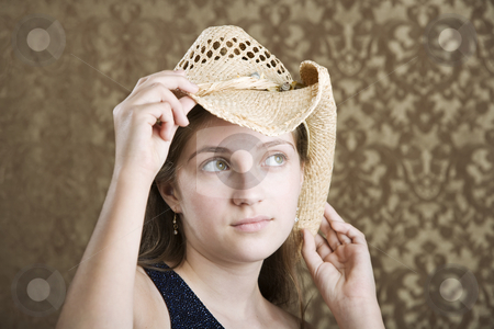 Confident Young Girl in a Cowboy Hat stock photo, Confident Young Girl in a Blue Dress and Cowboy Hat by Scott Griessel