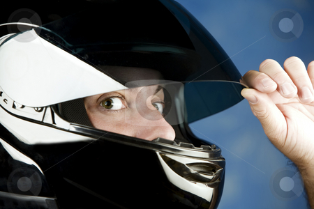 Wide-eyed man in a motorcycle helmet stock photo, Close-up of a wide-eyed man wearing a motorcycle helmet by Scott Griessel