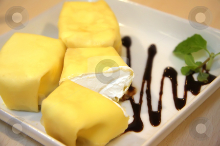 Stuffed crepes stock photo, Cream stuffed crepes on white plate by Kheng Guan Toh