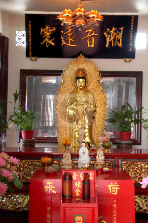 Toh Kheng Guan stock photo, Golden statue of Kuan Yin godess of mercy by Kheng Guan Toh