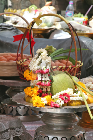 Thai buddhist offerings stock photo, Buddhist shrine offering in Thailand with fruits and flower garlands by Kheng Guan Toh