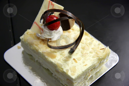 Sponge cake stock photo, Sansrival white sponge cake with icing rectangle cut by Kheng Guan Toh