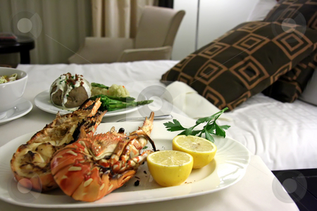 Room service lobster stock photo, Room service food presentation with hotel bed in background served lobster by Kheng Guan Toh