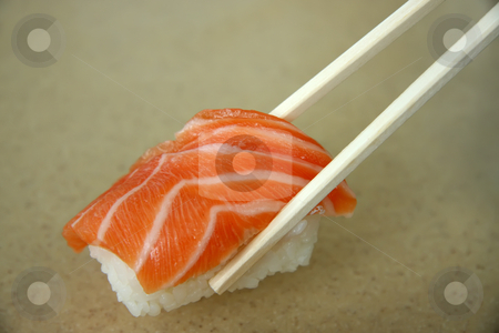 Salmon sashimi stock photo, Salmon sashimi held in chopsticks traditional japanese cuisine by Kheng Guan Toh