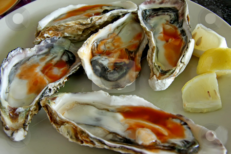 Raw oysters stock photo, Raw fresh oysters in half shell with spicy sauce by Kheng Guan Toh