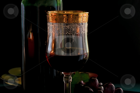 Goblet red wine stock photo, Goblet red blame, bottle, grapevine on black background by Vadim Maier