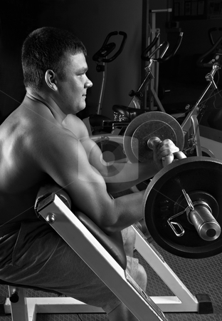 Lifting weights stock photo, Biceps exercise scott bench curl by Vadim Maier