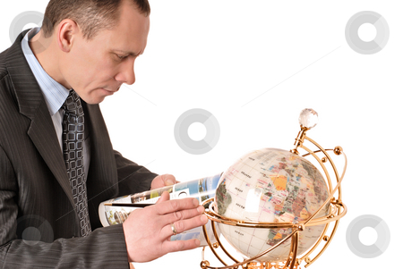 Man considers globe stock photo, Man looks globe choosing place for journey by Vadim Maier