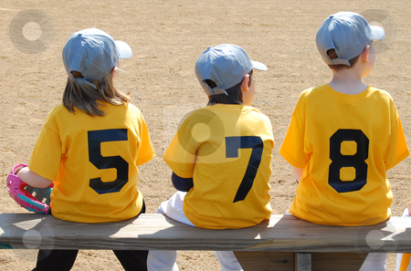 Three baseball players on the bench stock photo, Three baseball players on the bench by Heather Shelley