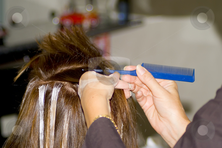 Hairdresser cutting hair stock photo, Hairdresser coloring hair. by Serge VILLA