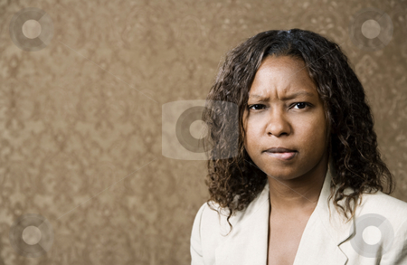 Concerned Pretty African-American Woman stock photo, Close-Up Portrait of a Concerned Pretty African-American Woman by Scott Griessel